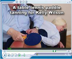 A table tennis paddle tanning for Kelly Wilson